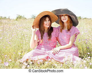 Two girls at contryside - Two girls at contryside in red...