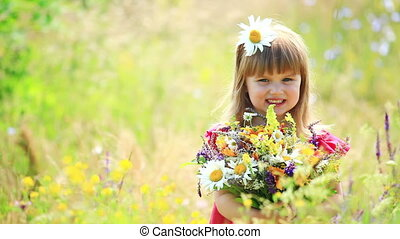Beautiful girl with flowers - Children outdoors