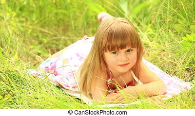 Girl lying on the grass - Children outdoors