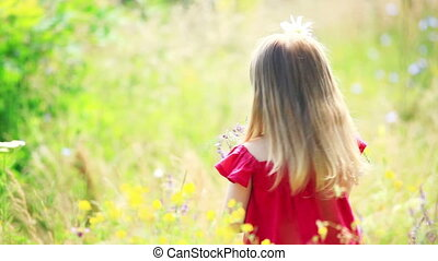Beautiful girl turning with flowers - Children outdoors