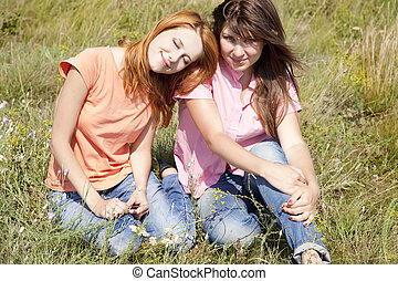 Two girlfriends at countryside