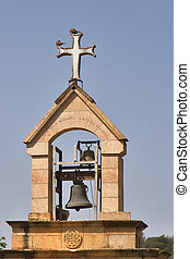 Belltower. - A belltower and a cross in old quarter of...