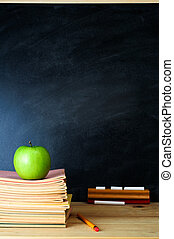 Teachers Desk and Chalkboard - A school chalkboard and...