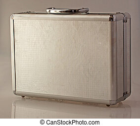 Case - Little metal case with reflection on gray background