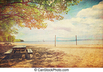 Picnic tables at the beach with retro feeling