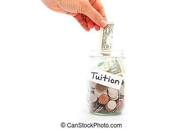 hand putting a dollar into a jar - education saving