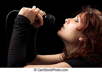 Woman Singing Tenderly - Rock Woman with Microphone Singing...