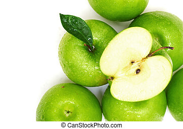Green apple fruits and half of apple and green leaves...