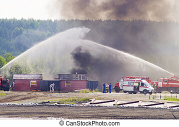 Firefighters work - Firefighter and ambulance team work at...