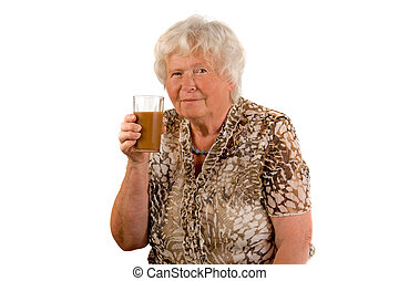 senior lady with a glass of juice