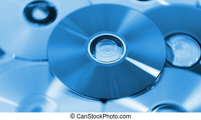 Background of compact discs in blu - Rotating compact discs...