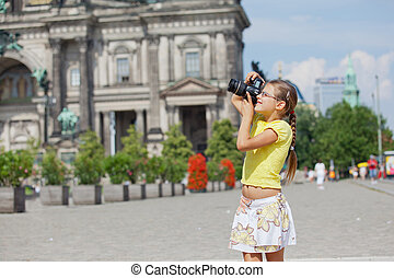 young girl with photo camera on Cathedral in Berlin...
