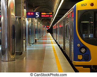 Brightly colored subway station - A brightly colored train...