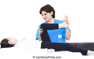 Physiotherapy for children to legs - Masseuse stretching the...
