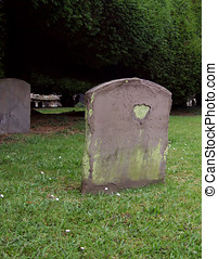 Old Headstones - Old weathered grave headstones in...