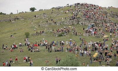 Crowd of spectators - Large group of people relaxing in...