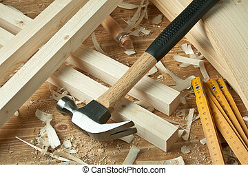 Wood working - Wooden planks, hammer and ruler.