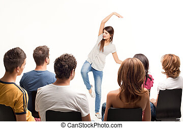 young brunette woman gesturing at crowd