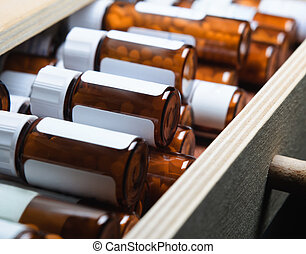 Homeopathic Remedy Bottles - An open drawer, filled with...