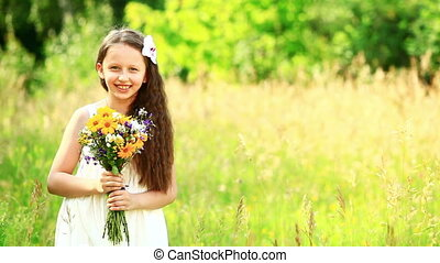Girl laughing with flowers