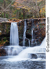 Autumn Waterfall in mountain - Waterfall with trees and...