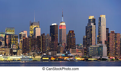 New York City Manhattan midtown skyline panorama at dusk...