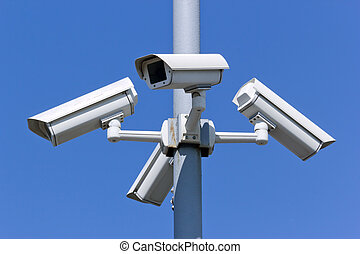 security cameras - four security cameras on blue sky