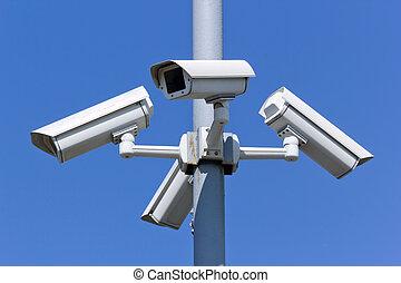 security cameras - four security cameras on blue sky