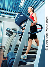 walking - Sporty young woman in the gym centre