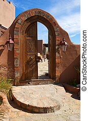 Large Arched Ornate Double Door with Brick - Large, arched,...