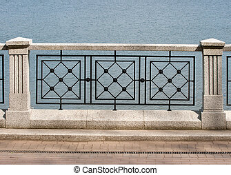 detail of granite and metal fence - element of granite and...