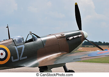 Spitfire standing on runway - front of spitfire on runway