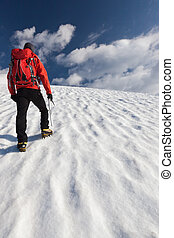 Mountaineer alone glacier - A male mountaineer walking...
