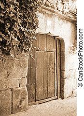Old wooden gate in Segovia Spain