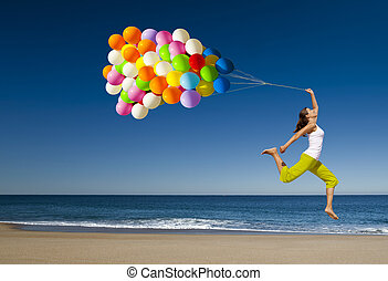 Jumping with balloons - Beautiful and athletic girl with...