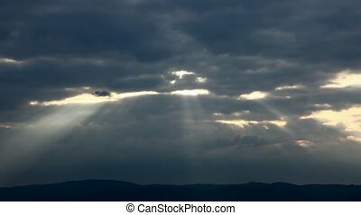 Sun rays fading away in evening - Time lapse recording of...