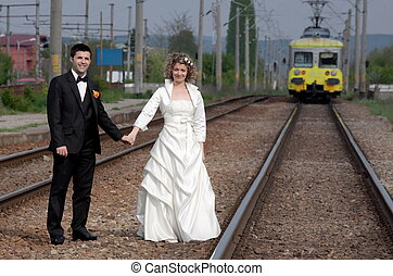 New begining in old way - Newlyweds waiting their train on...