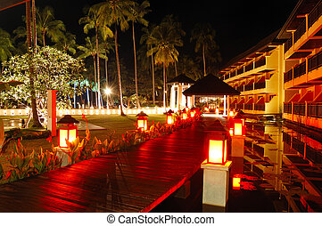 Illuminated relaxation area of luxury hotel, Koh Chang...