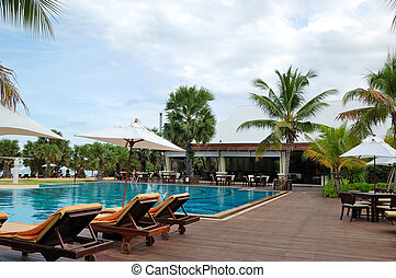 Swimming pool at the beach and bar of the popular hotel, Pattaya, Thailand