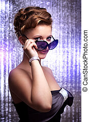 sexy young woman wearing sunglasses - Young woman wearing...