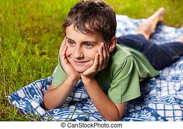Happy boy outdoor - Closeup portrait of a happy boy smiling,...