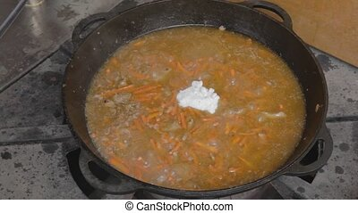 Adding salt to stewing pork - Add two full tablespoons with...