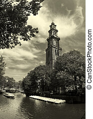 Amstel river and Westerkerk church in Amsterdam - View on...