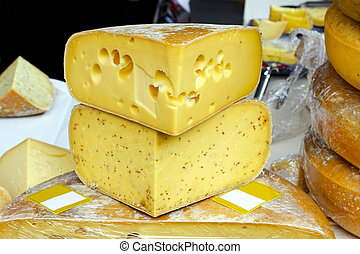Emmentaler cheese - Variety of different cheeses pile on...
