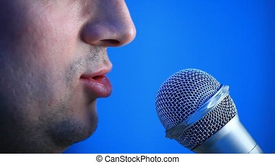 Talking man - Side view of talking man with microphone