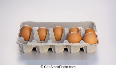 Hand completing carton of eggs - Hand completing the missing...