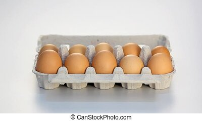Hands taking eggs from carton - Hands taking out all the...