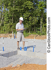 Building Inspector - Building inspector checking new...