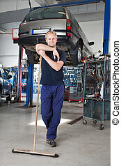 Clean Mechanic Garage - Full length portrait of young man...