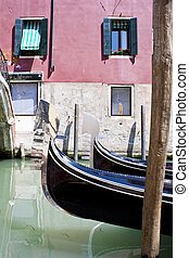 Gondola in canal Venice